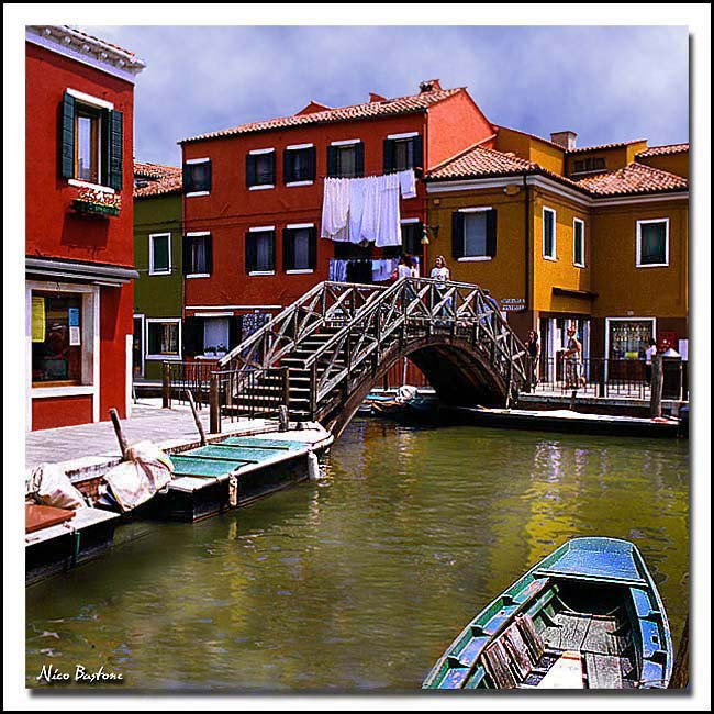 Burano - Venice -  A canal with a wooden bridge